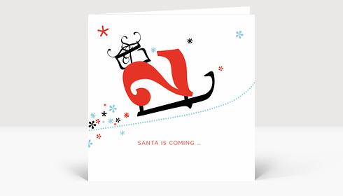 Weihnachtskarte Weihnachtsschlitten mit Geschenken und Sternen