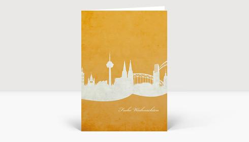 Weihnachtskarte Skyline Köln auf hellorange