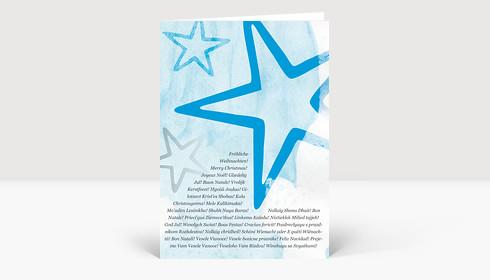 Weihnachtskarte Sterne Blau mit internationalen Weihnachtsgrüßen