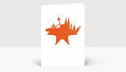 Weihnachtskarte Köln Collage orange mit Stern von Weihnachtsgrüßen umrundet