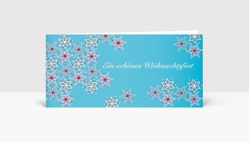 Weihnachtskarte Schneeflocken auf blauer Karte