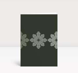 Weihnachtskarte Schneeflocken auf grau