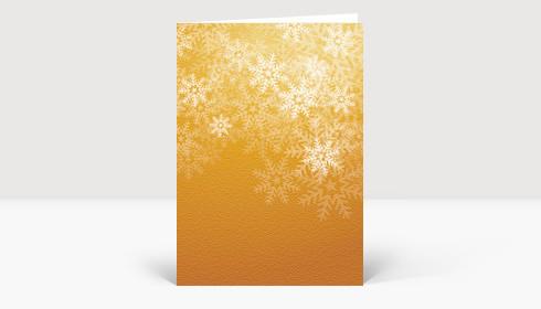 Weihnachtskarte Schneeflocken auf orangefarbener Struktur